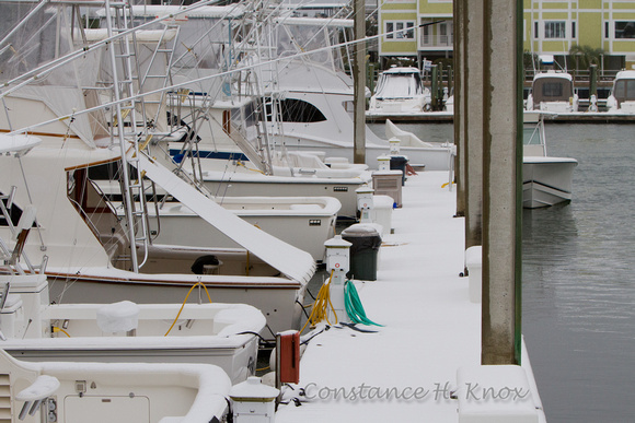 Boats and Dock in Snow